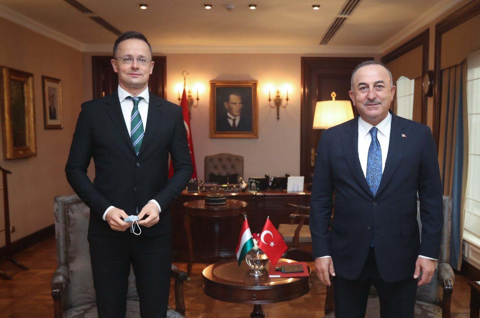 Foreign Minister Mevlüt Çavuşoğlu hosts his Hungarian counterpart Peter Szijjarto in the capital Ankara, Dec. 8, 2020. (AA Photo)