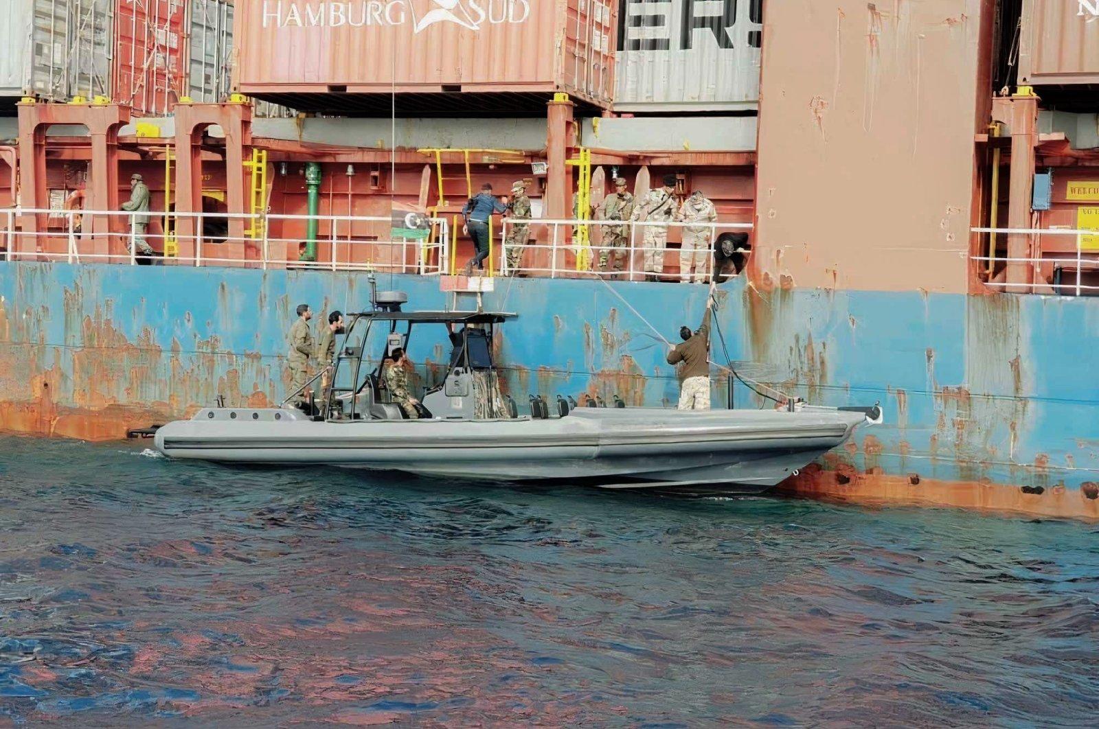 Forces linked to putschist Gen. Khalifa Haftar board a Turkish ship off the Libyan coast, Dec. 08, 2020. (AA Photo)