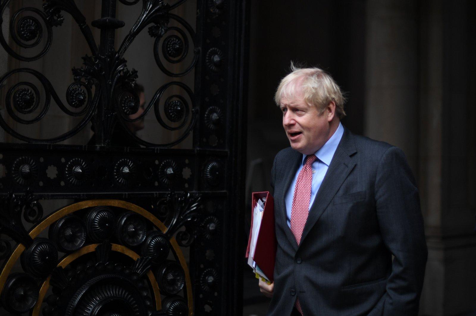 Britain's Prime Minister Boris Johnson returns to 10 Downing Street, London, Dec. 8, 2020. (AFP Photo)
