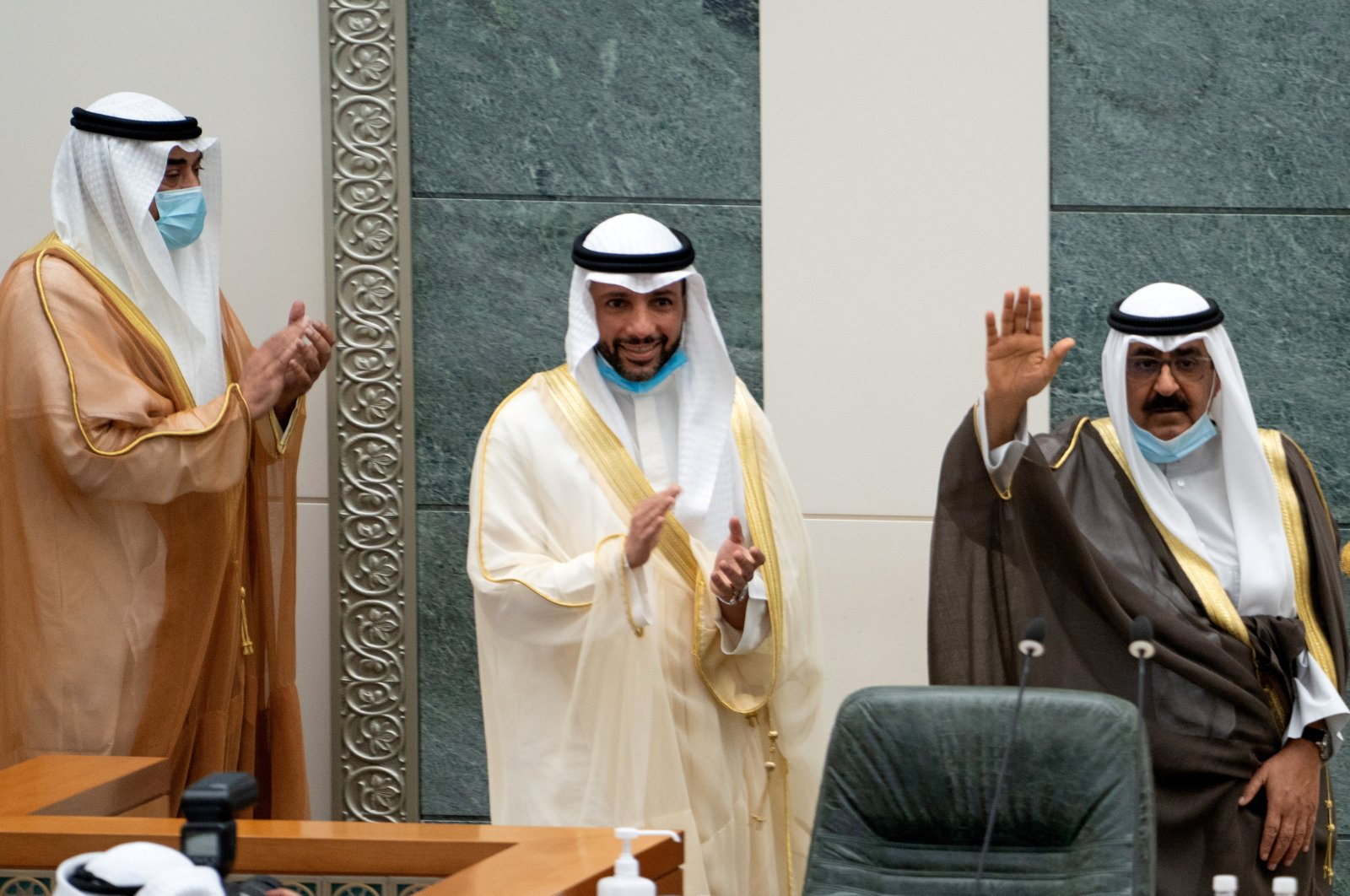 Kuwait's newly appointed crown prince Sheikh Meshal Al Ahmad Al Jaber Al Sabah waves before he is sworn in, as speaker of parliament Marzouq al-Ghanim, and Kuwait's Prime Minister Sheikh Sabah Al Khalid Al Sabah clap, at the parliament, in Kuwait City, Kuwait, Oct. 8, 2020. (Reuters Photo)