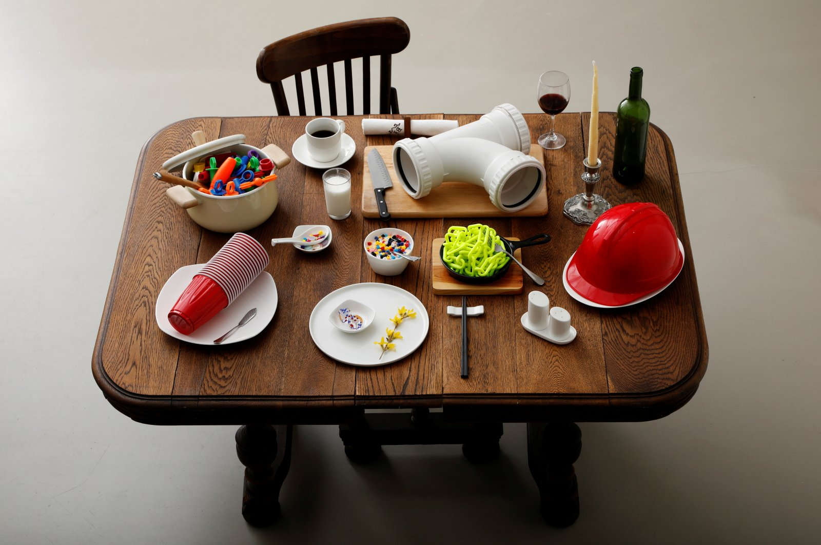 Various plastic goods weighing 3.15 kilograms, which is equivalent to the amount of plastic that someone could eat in ten years, are displayed on a table in this illustration taken in Tokyo, March 31, 2020. (Reuters Photo)