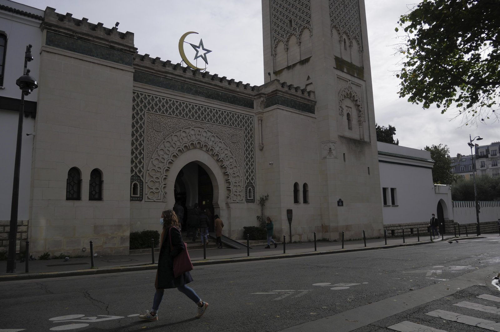 A woman walks outside the Paris mosque, in Paris, France, Oct. 29, 2020. (AP Photo)