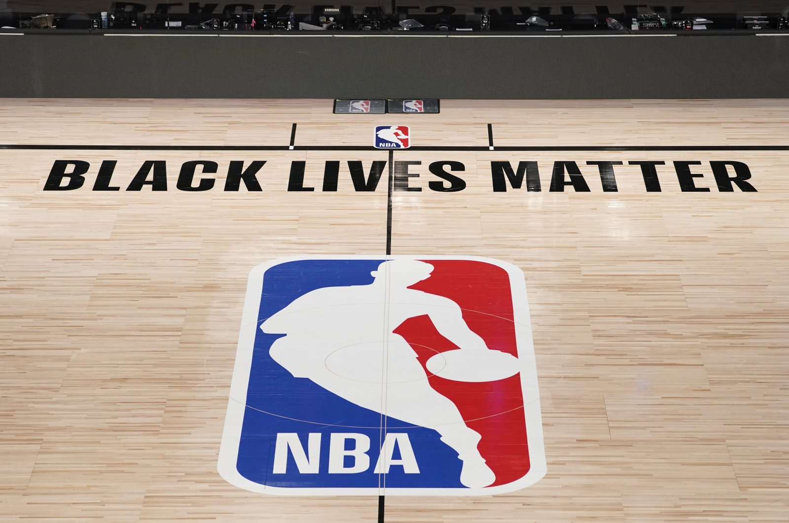 NBA logo is displayed in an empty basketball arena in Lake Buena Vista, Florida, U.S., Aug. 28, 2020. (AP Photo)