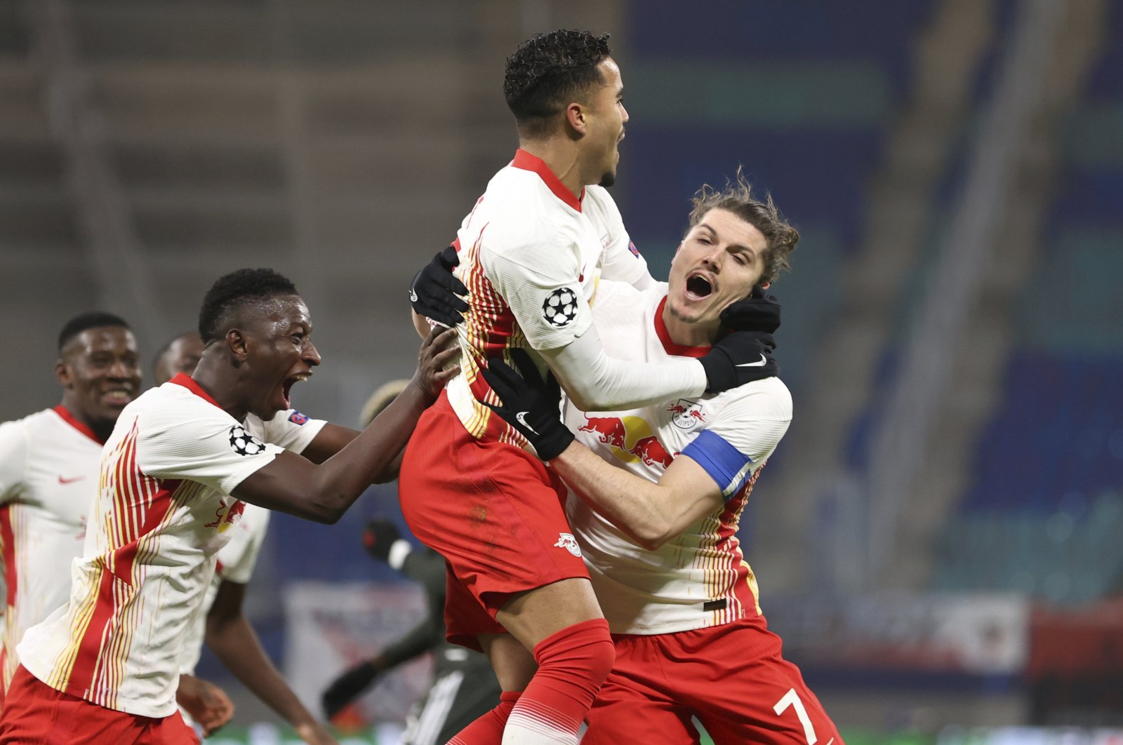 Leipzig's Justin Kluivert (C) celebrates scoring the third goal during the Champions League match against Manchester United at the RB Arena in Leipzig, Germany, Dec. 8, 2020. (DPA via AP Photo)