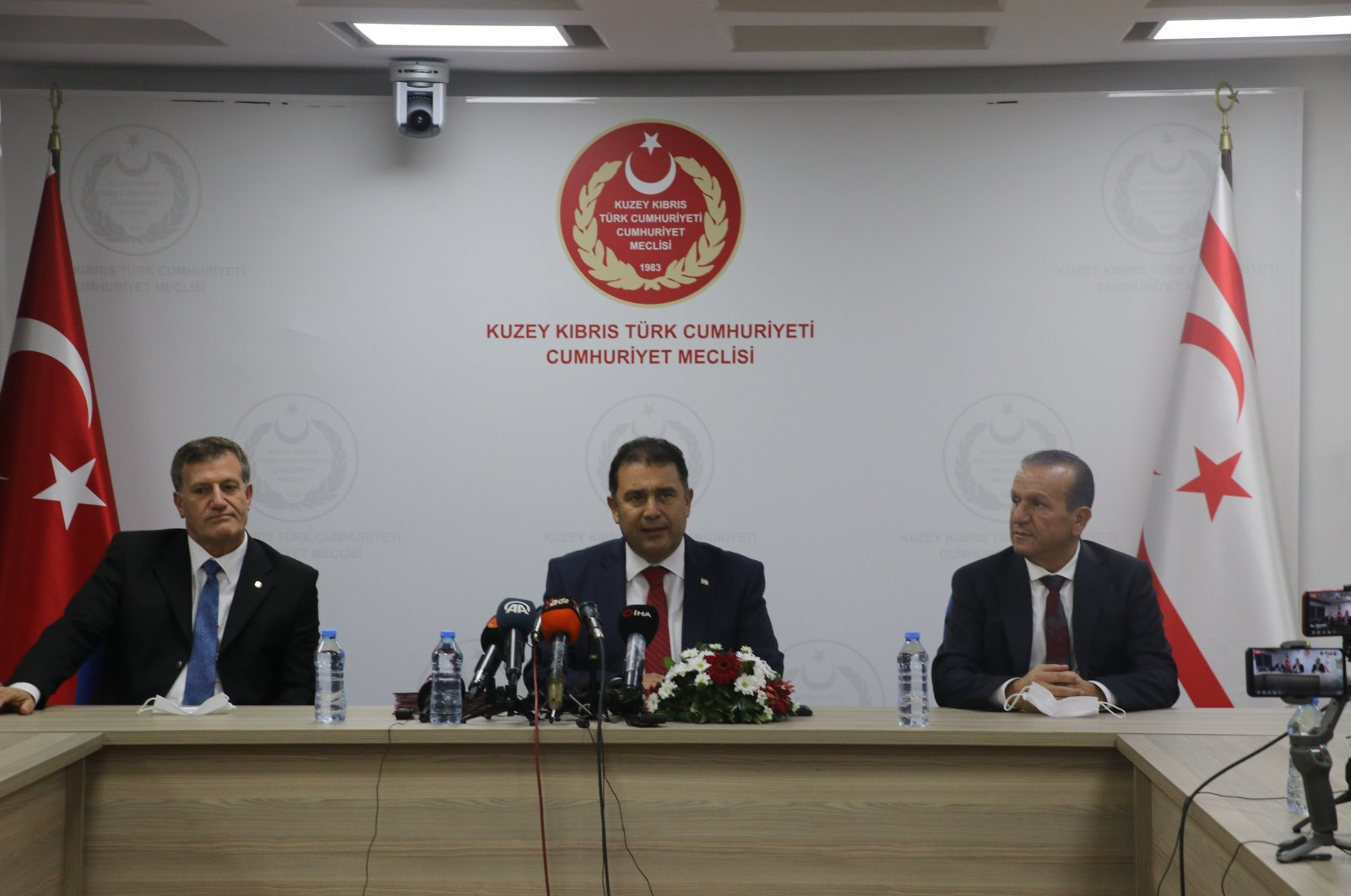 Vice Chairperson Ersan Saner (C), DP Chairperson Fikri Ataoğlu (R) and YDP Chairperson Erhan Arıklı sign an accord to form a coalition government in the TRNC on Dec. 8, 2020 (AA Photo)