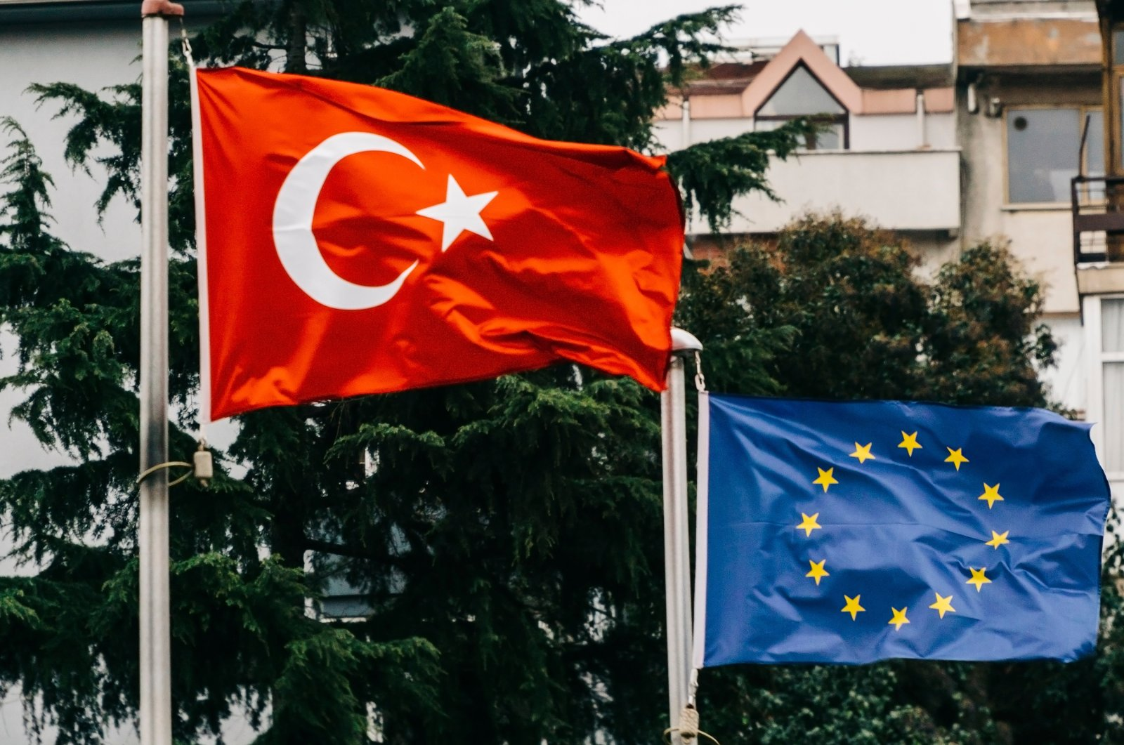 The flags of Turkey and the European Union wave in front of a building in the Etiler neighborhood of Beşiktaş district, Istanbul, Turkey, March 21, 2019. (Shutterstock Photo)