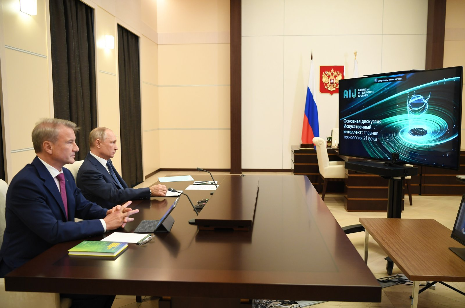 Russian President Vladimir Putin (R) and Sberbank CEO Herman Gref attend the online AI Journey conference, Moscow, Russia, Dec. 4, 2020. (Photo by Getty Images)