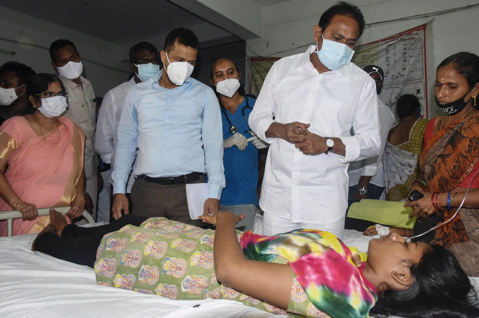 Andhra Pradesh Health Minister Alla Nani (2nd R) visits patients receiving medical care for a mystery illness at a goverment hospital in Eluru, India, Dec. 6, 2020. (Public Relation Department of Government of Andhra Pradesh / AFP)