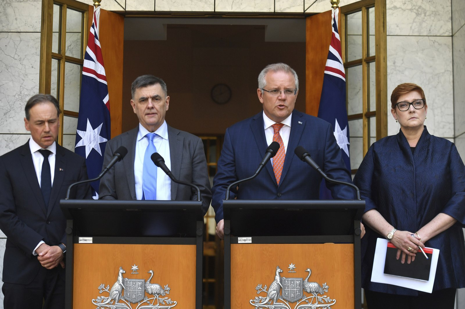 Australian Minister for Health Greg Hunt (L), Chief Medical Officer Brendan Murphy (2nd from L), Prime Minister Scott Morrison (2nd from R) and Minister for Foreign Affairs Marise Payne (R), give an update on the coronavirus at a news conference at Parliament House in Canberra, Australia, Jan. 29, 2020. (AP Photo)