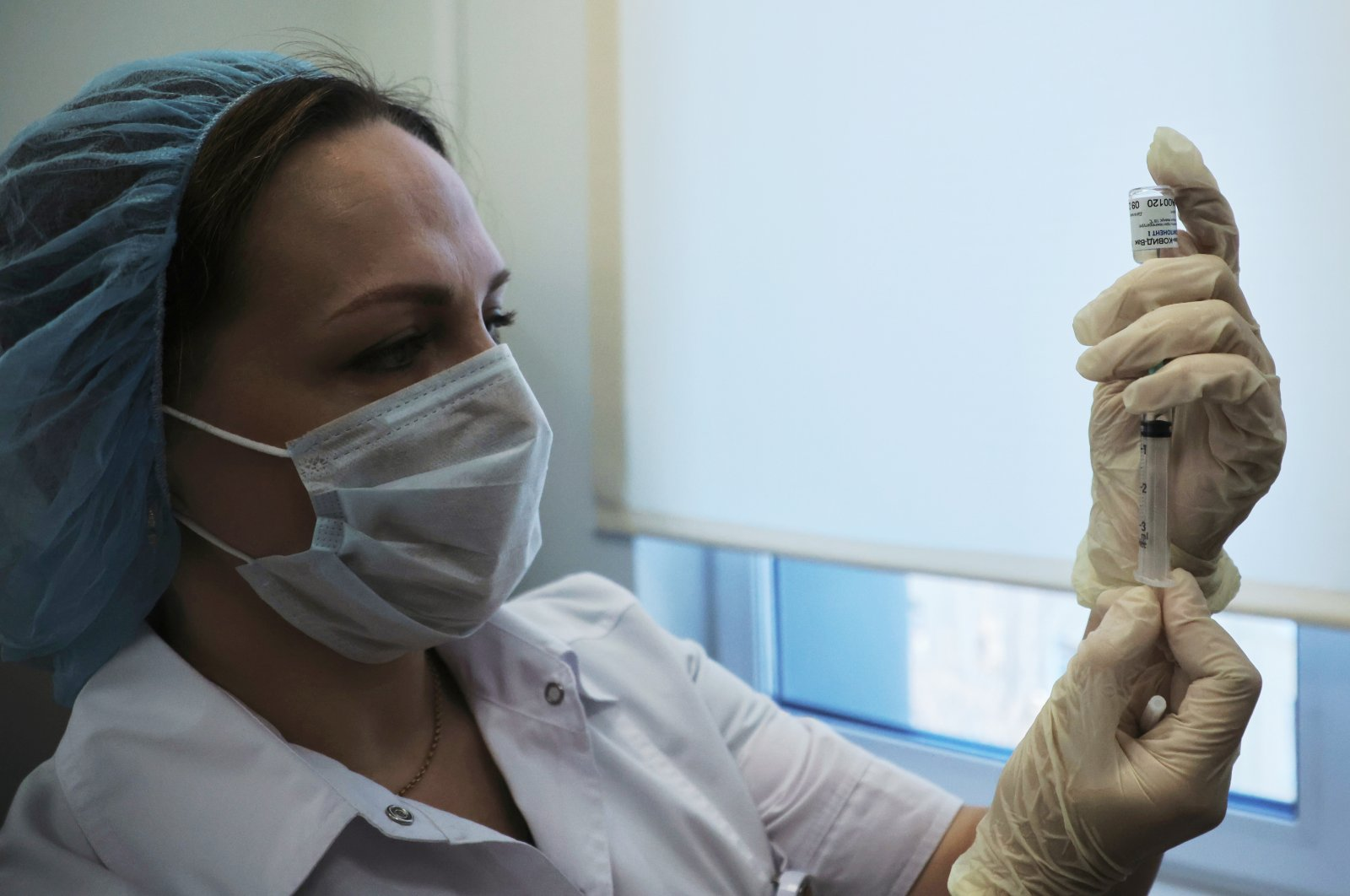 A medical worker fills a syringe with the Sputnik-V vaccine in Moscow, Russia, Dec. 5, 2020. (Reuters Photo)