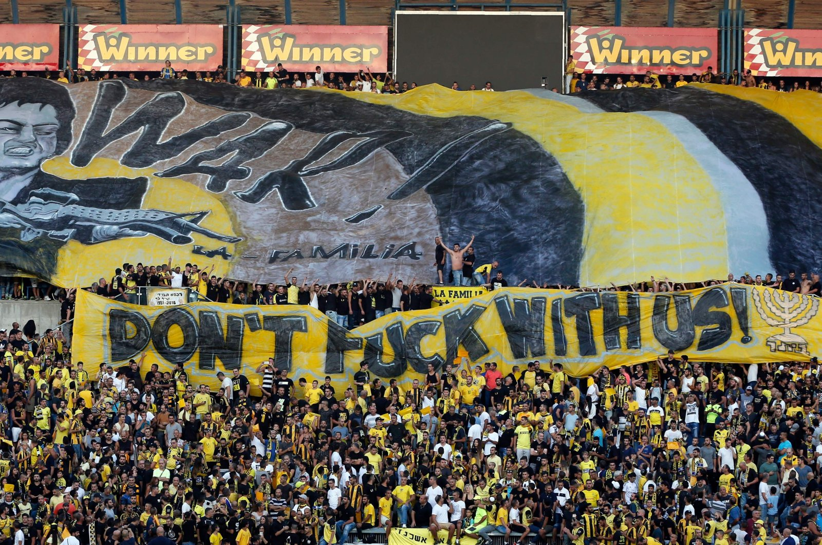 Beitar Jerusalem fans hold up banners prior to the UEFA Europa League play-off football match between Beitar Jerusalem and AS Saint-Etienne, at the Itztadion Teddy Stadium in Jerusalem, Aug. 17, 2016. (AFP Photo)