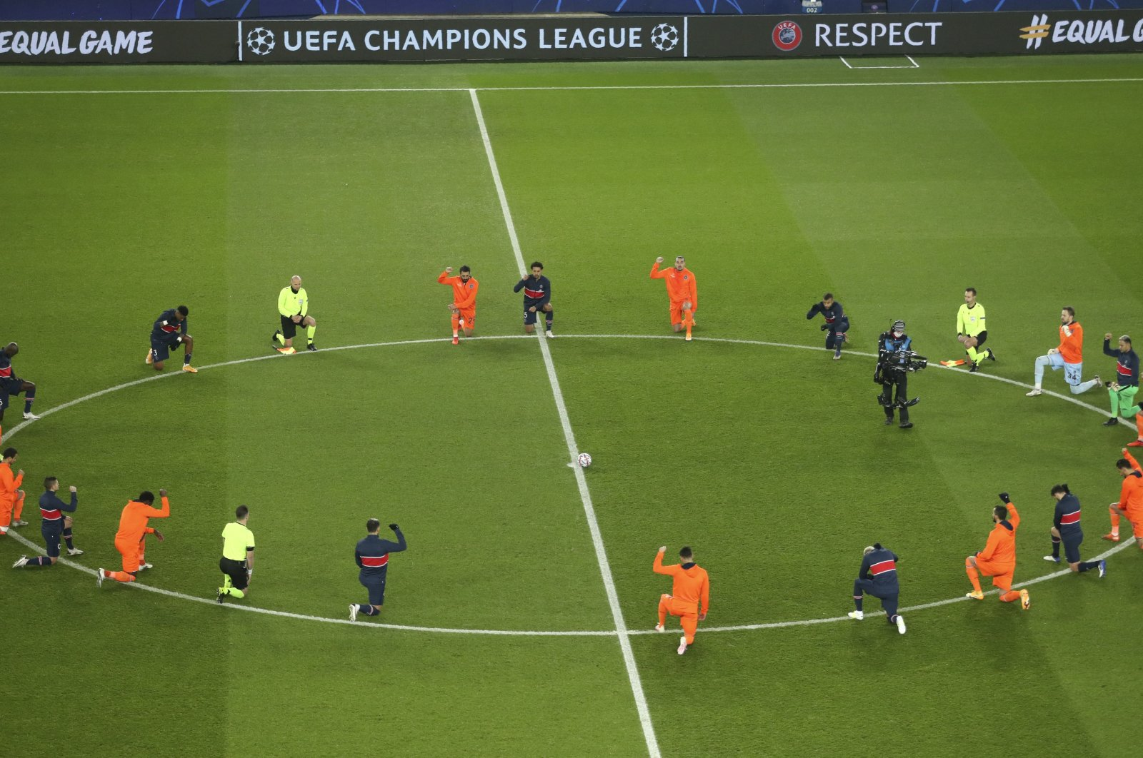 Players kneel in support of the Black Lives Matter campaign before the start of the Champions League group H soccer match between Paris Saint Germain and Istanbul Başakşehir at the Parc des Princes stadium in Paris, France, Dec. 9, 2020. (AP Photo)