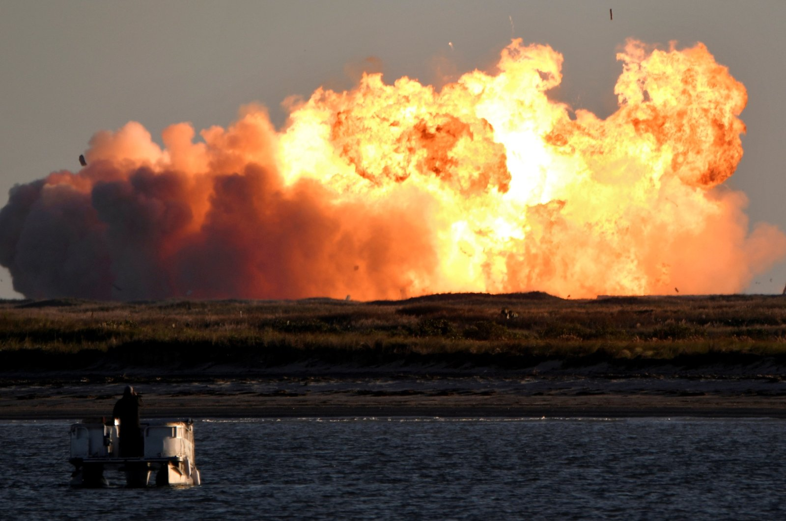 SpaceX's first super heavy-lift Starship SN8 rocket explodes during a return-landing attempt after it launched from their facility on a test flight in Boca Chica, Texas, U.S., Dec. 9, 2020. (Reuters Photo)