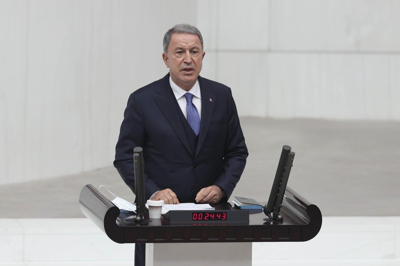 Defense Minister Hulusi Akar speaks during the 2021 budget debates in the Turkish Parliament, Ankara, Turkey, Dec. 9, 2020. (AA Photo)