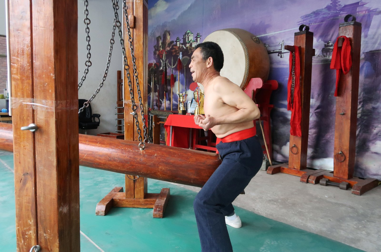"Wang Liutai demonstrates ""iron crotch kung fu"" at his martial arts academy in the Juntun village of Luoyang, China, Dec. 5, 2020. (Reuters Photo)"