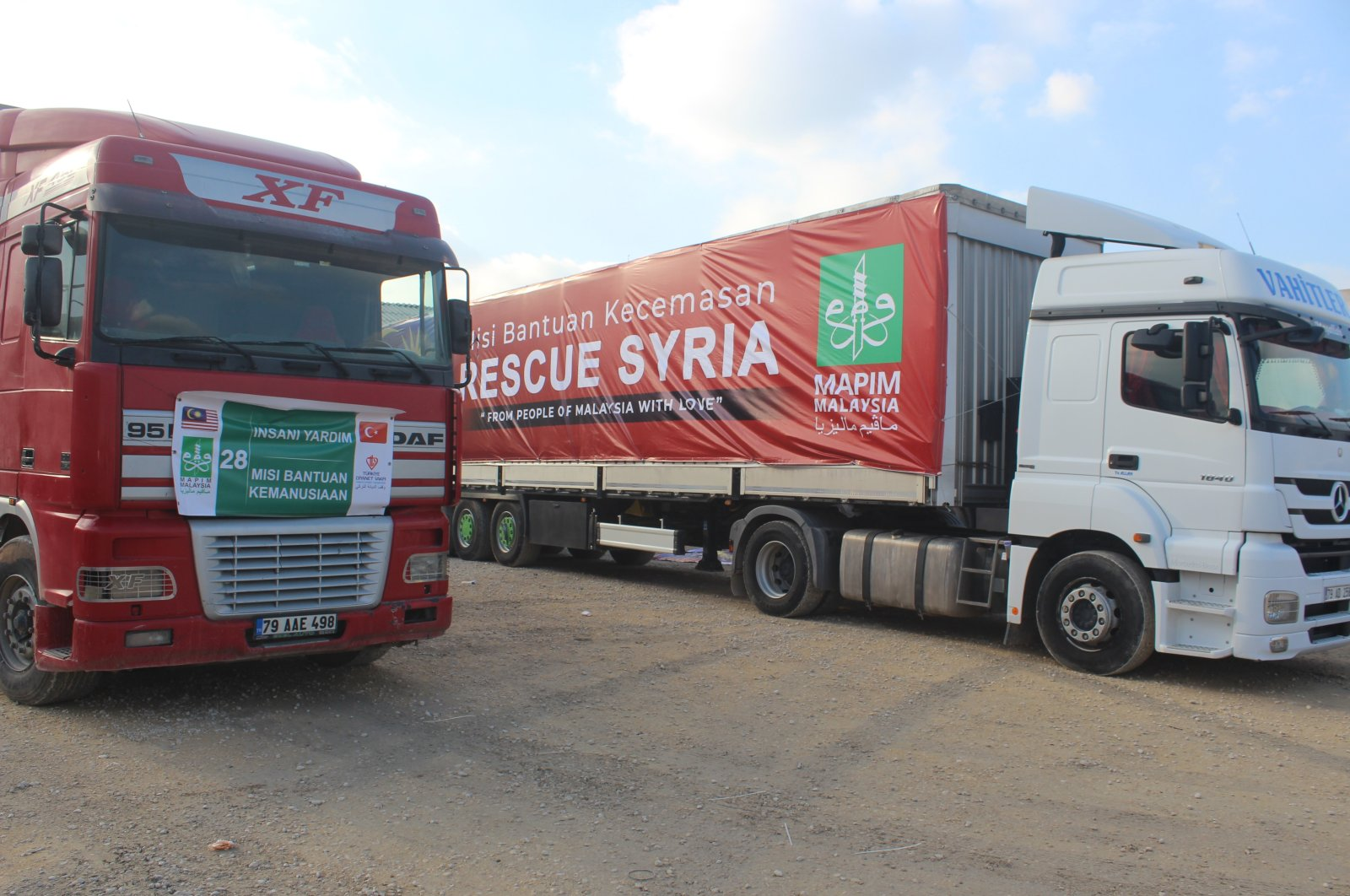 Trucks full of aid sent by the Türkiye Diyanet Foundation (TDV) and the Malaysian Consultative Council for Islamic Organization to Syria, Dec. 9, 2020. (AA Photo)