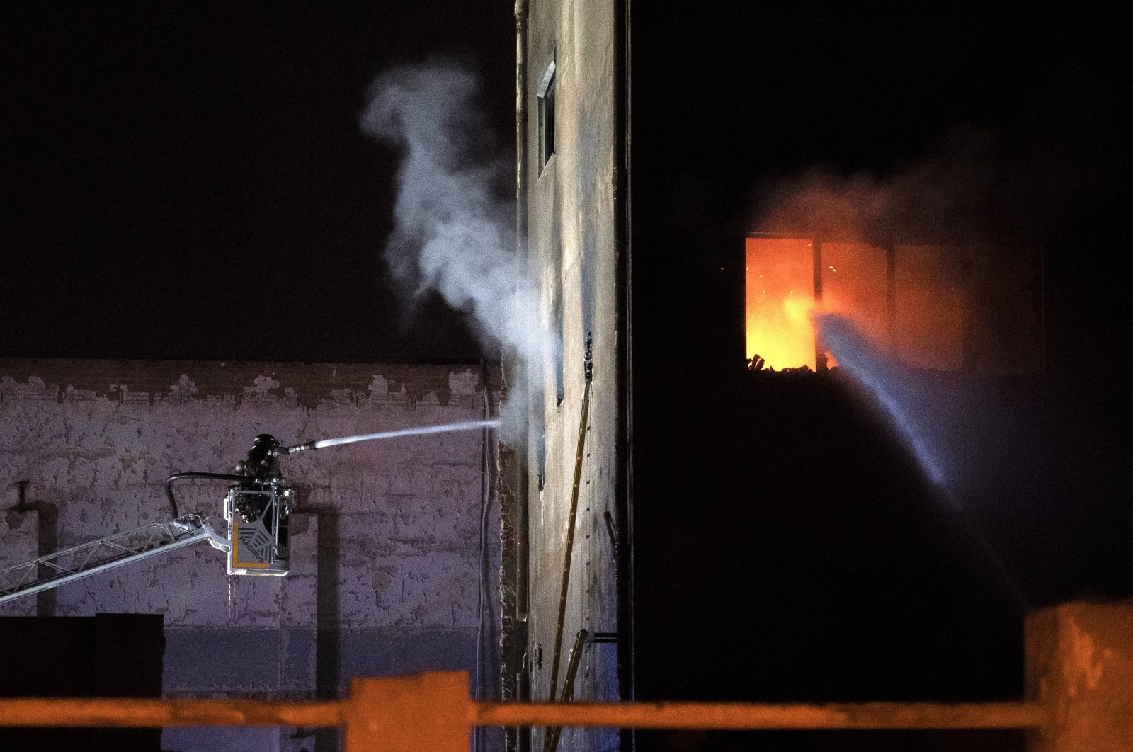 Firefighters work to extinguish a fire at a building in Badalona, Barcelona, Spain, Dec. 10, 2020. (AP Photo)