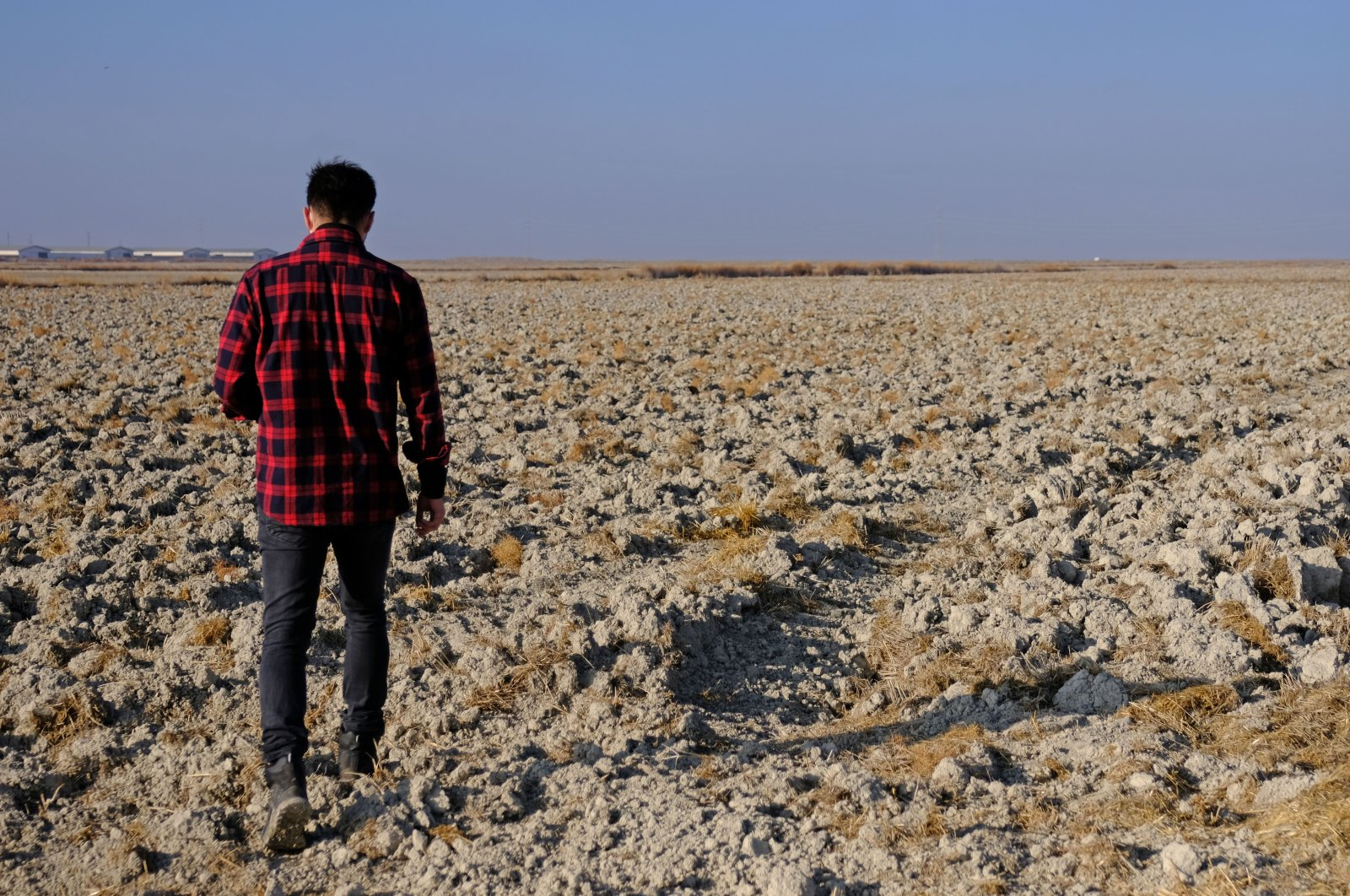 A man walks on the lands hit by drought in Konya, central Turkey, Dec. 10, 2020. (DHA PHOTO)