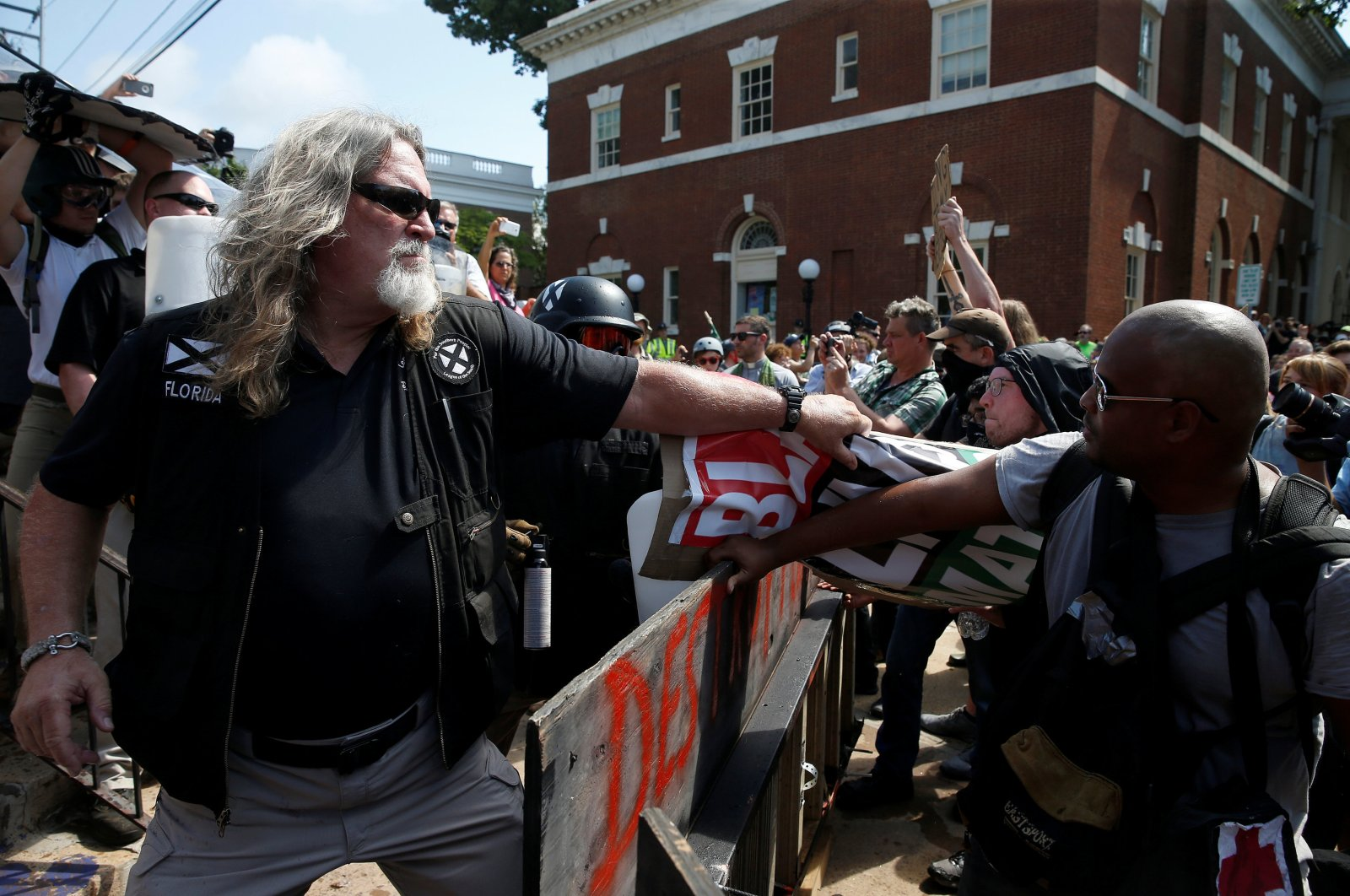 A white supremacist grabs a counter protesters' sign during a rally in Charlottesville, Virginia, U.S., Aug. 12, 2017. (Reuters Photo)