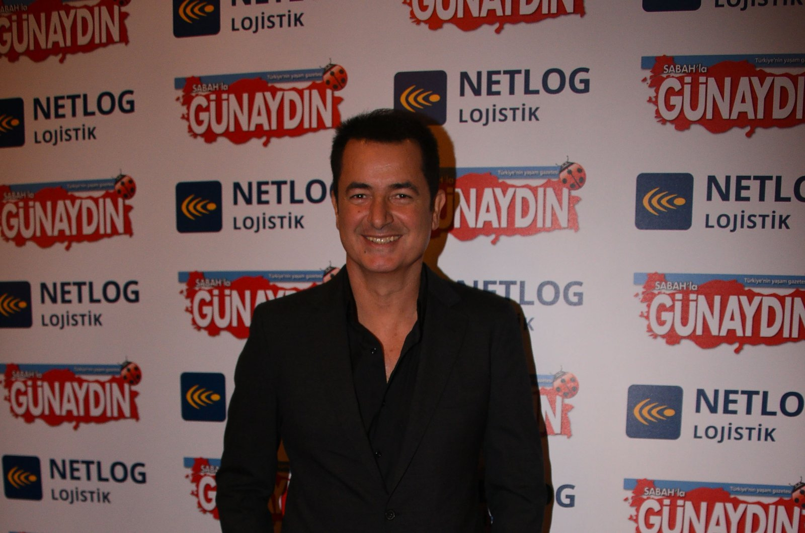 Turkish media magnate Acun Ilıcalı poses at the entrance of an event in Istanbul, Dec. 19, 2018. (Sabah File Photo)