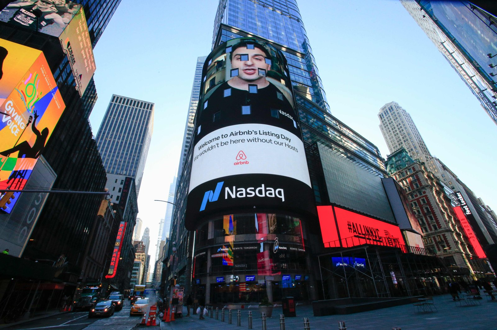 The Airbnb logo is displayed on the Nasdaq digital billboard in Times Square in New York, U.S., Dec. 10, 2020. (AFP Photo)