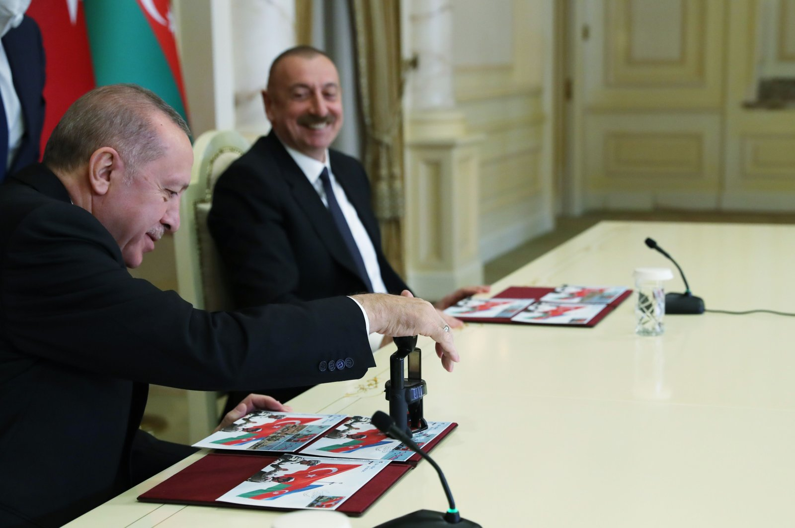 A handout picture taken and released on Dec. 10, 2020, by the Turkish presidential press service shows Turkish President Recep Tayyip Erdoğan and Azerbaijani President Ilham Aliyev holding a news conference following their meeting in Baku, Azerbaijan. (AFP Photo)