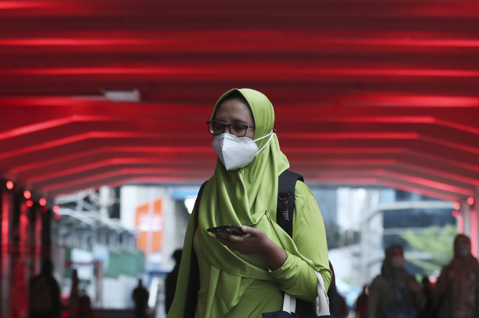 A woman wears a face mask to help curb the spread of the coronavirus in Jakarta, Indonesia. Monday, Dec. 7, 2020. (AP Photo)