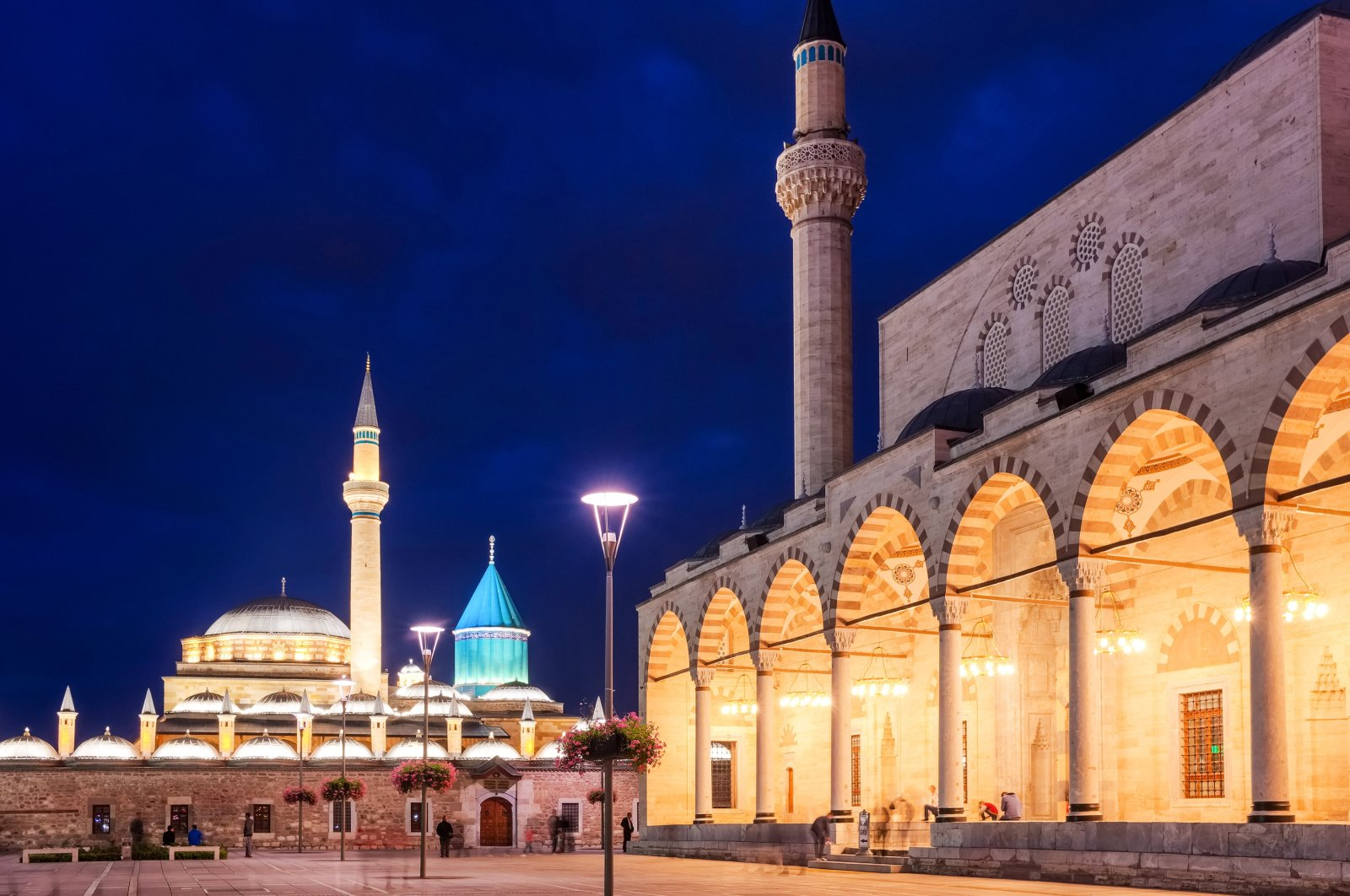 The central square of the old town of Konya with the Mevlana Museum in the background and Selimiye Mosque at night. (Shutterstock Photo)