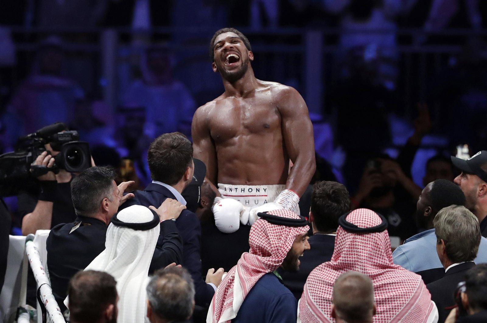 Anthony Joshua celebrates after beating Andy Ruiz Jr. to win their World Heavyweight Championship contest at the Diriyah Arena, Riyadh, Saudi Arabia, Dec. 8, 2020. (AP Photo)