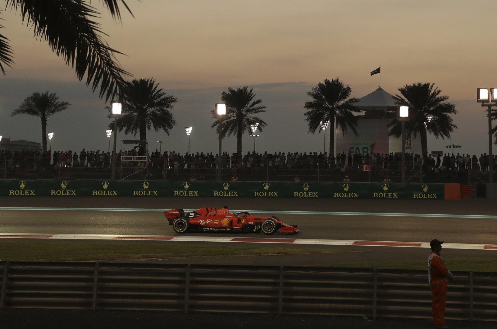 Ferrari driver Sebastian Vettel steers his car during the Formula One Abu Dhabi Grand Prix, at the Yas Marina racetrack in Abu Dhabi, UAE, Dec.1, 2019. (AP Photo)