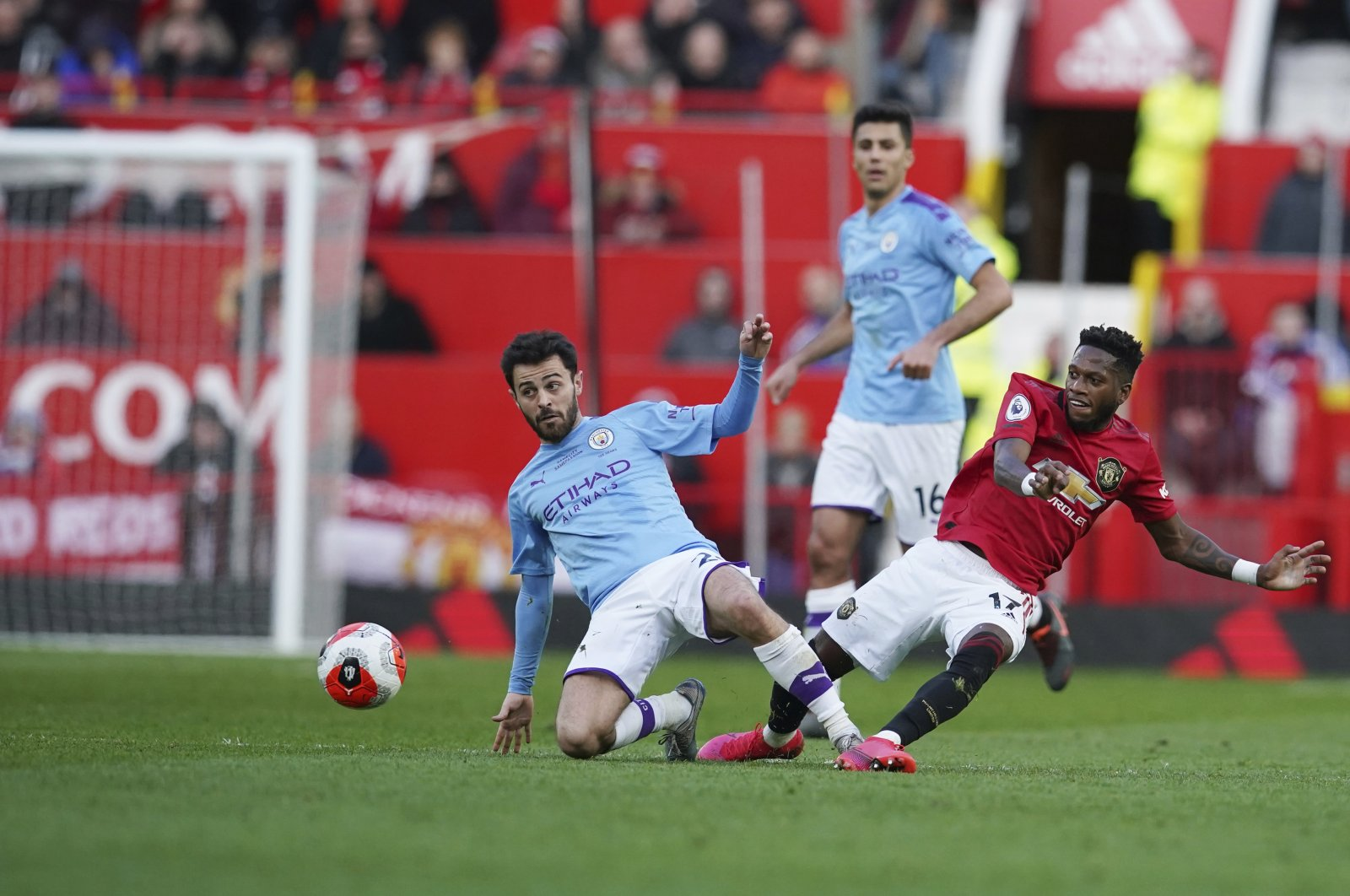Manchester City's Bernardo Silva (L) and Manchester United's Fred in action during a Premier League match at Old Trafford stadium in Manchester, England, March 8, 2020. (AP Photo)
