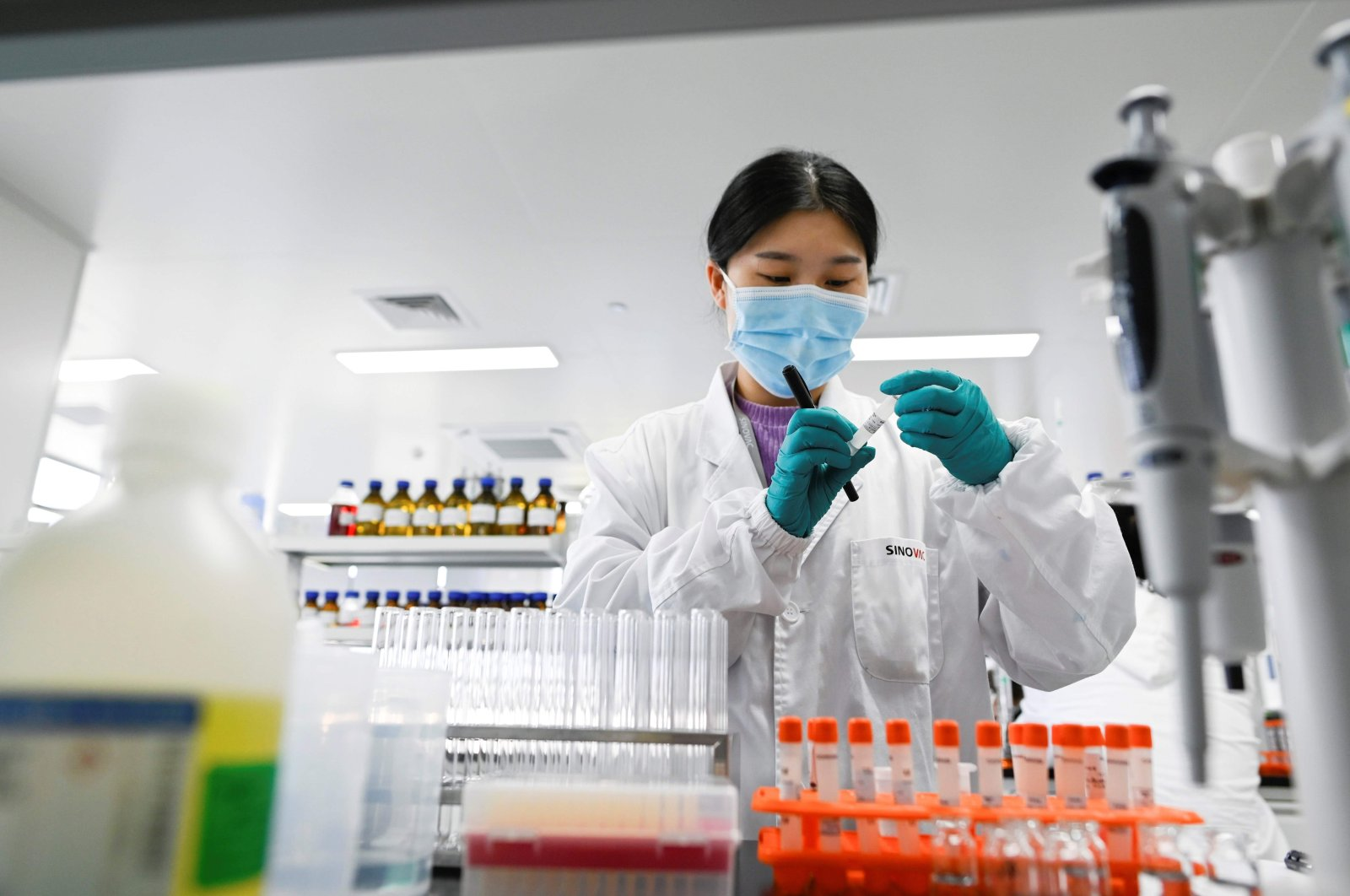 An engineer works on a COVID-19 vaccine at a laboratory of the Chinese pharmaceutical firm Sinovac, Beijing, China, Sept. 24, 2020. (AFP Photo)