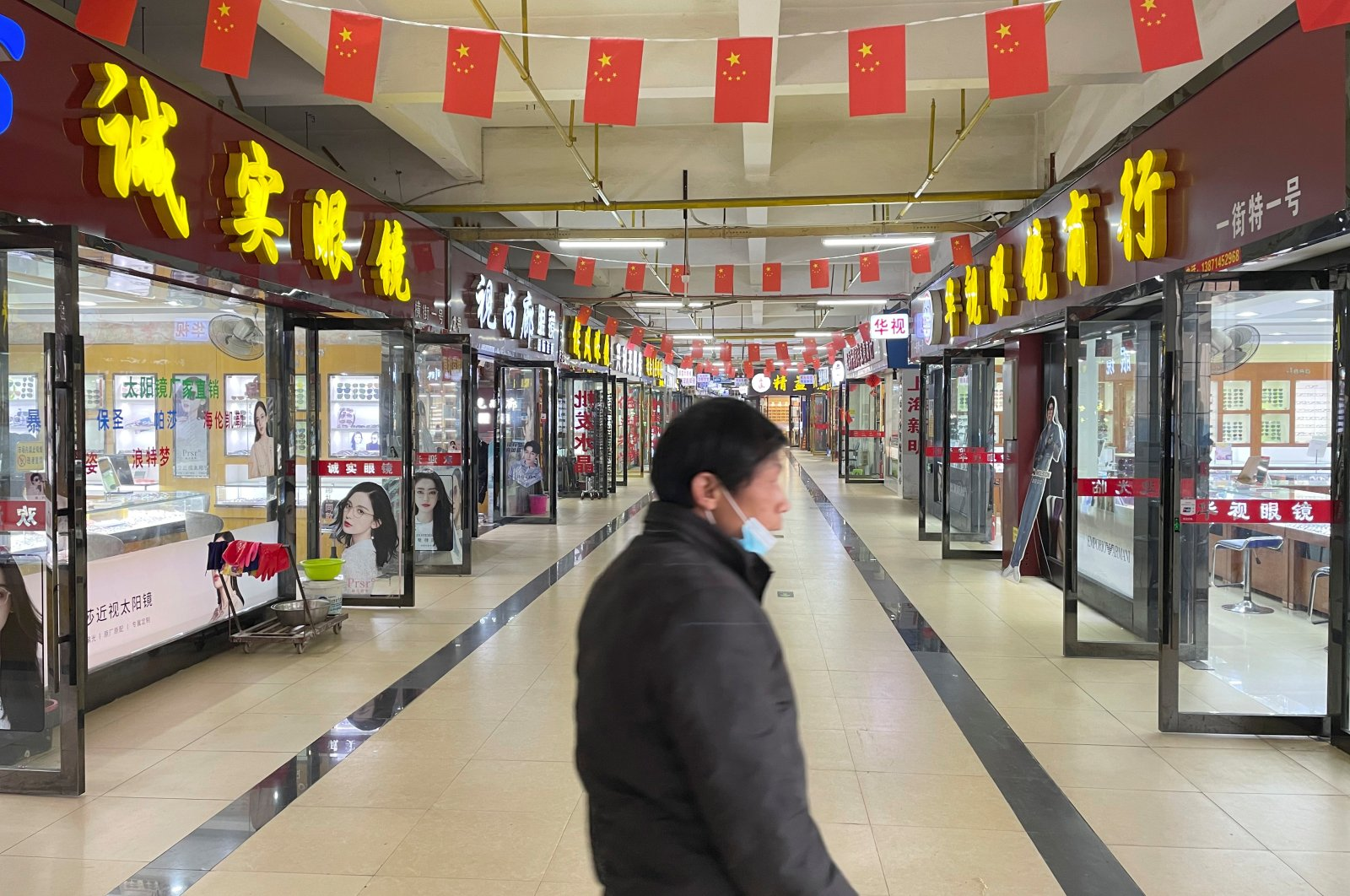 Optical shops are seen open which were originally at the second floor of the Huanan seafood market, Wuhan, China, Dec. 8, 2020. (REUTERS Photo)