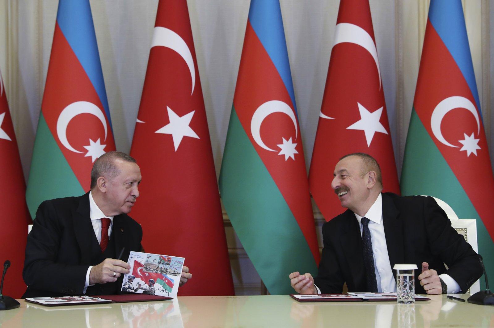 President Recep Tayyip Erdoğan (L) and Azerbaijan's President Ilham Aliyev talk during a joint news conference following their meeting in Baku, Azerbaijan, Dec. 10, 2020. (AP Photo)