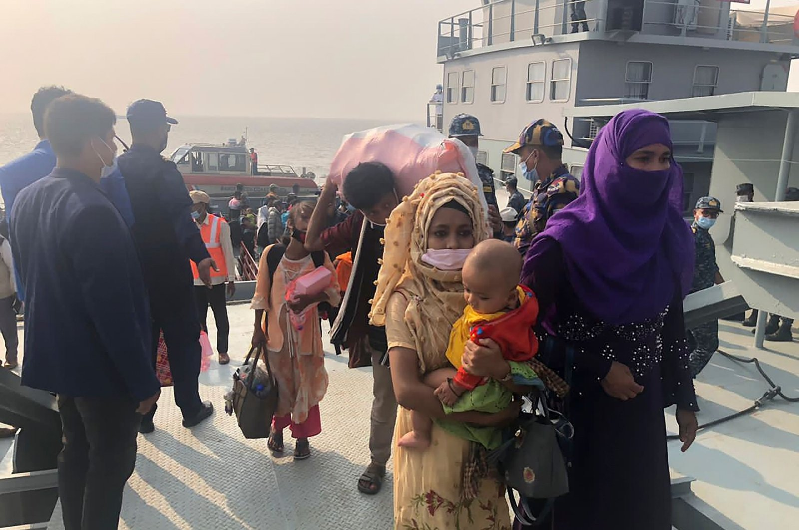 Rohingya refugees disembark from a Bangladeshi navy ship to the island of Bhashan Char, Noakhali, Dec. 4, 2020. (AFP Photo)