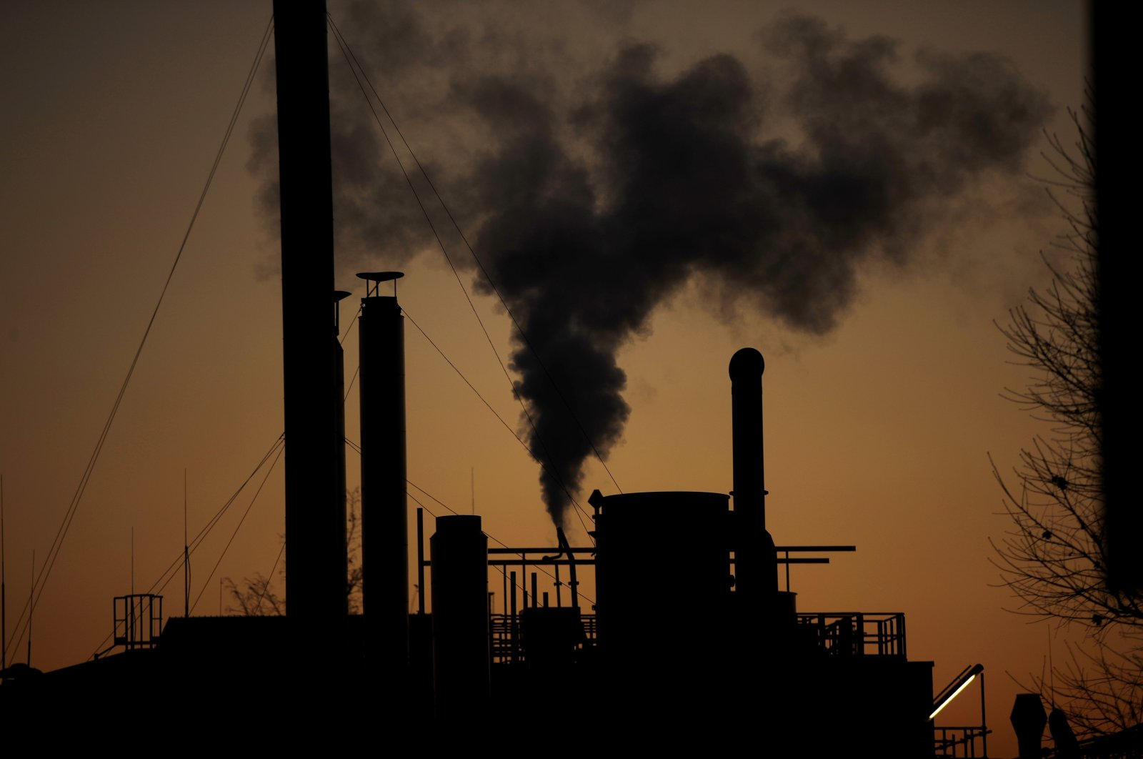 Smoke billows from a chimney of a factory, in Ospiate, near Milan, Italy, Dec. 14, 2018. (AP Photo)