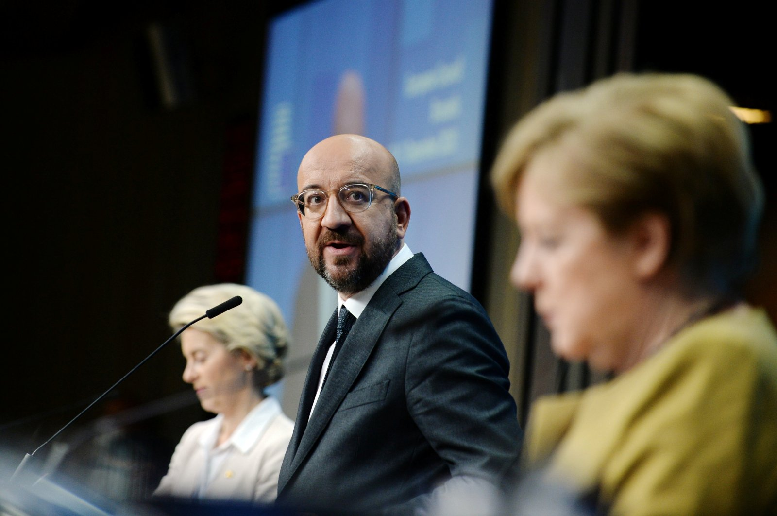 European Commission President Ursula von der Leyen (L), European Council President Charles Michel (C) and German Chancellor Angela Merkel (R) hold a news conference at the end of a EU leaders summit in Brussels, Belgium, Dec. 11, 2020.  (REUTERS Photo)