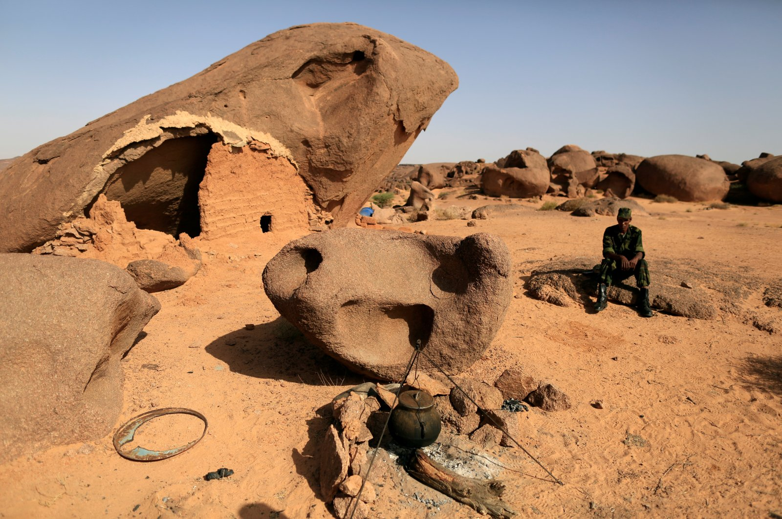 A Polisario fighter sits on a rock at a forward base on the outskirts of Tifariti, Western Sahara, Sept. 9, 2016. (Reuters Photo)