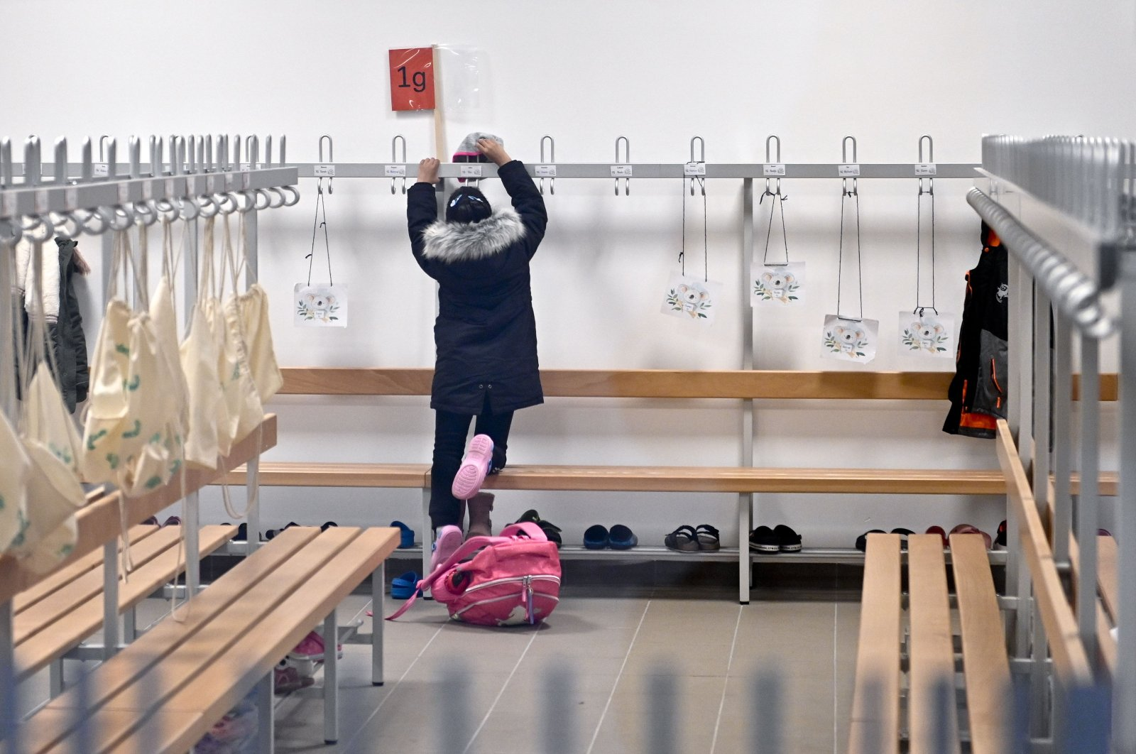 A schoolchild is pictured in the empty wardrobe of an elementary school in Vienna, Austria, on Nov. 17, 2020. (AFP Photo)