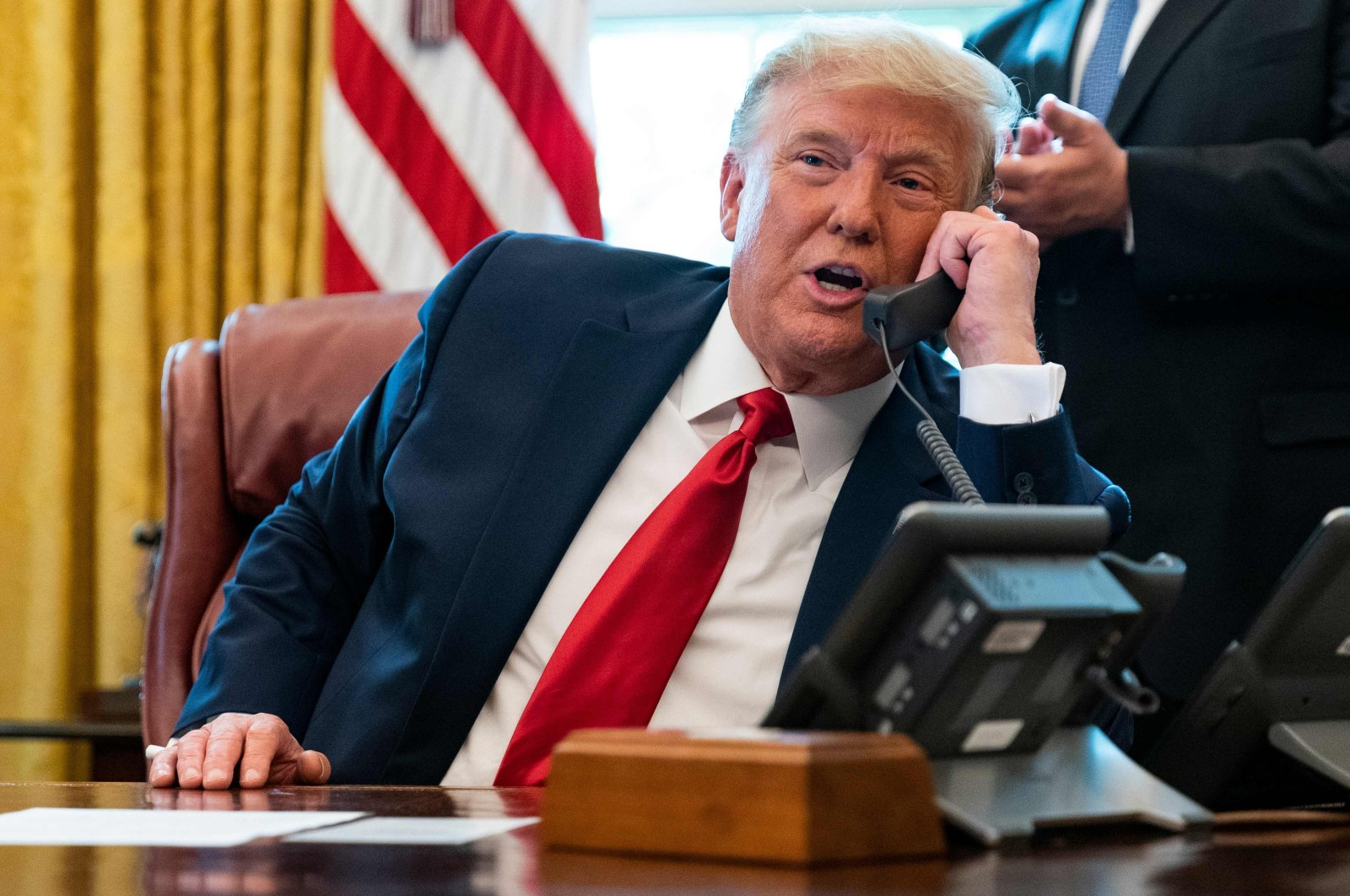 In this file photo taken on October 23, 2020 US President Donald Trump speaks to the leaders of Sudan and Israel as he announces that Sudan will normalize relations with Israel at the White House in Washington, DC, on October 23, 2020. (AFP Photo)