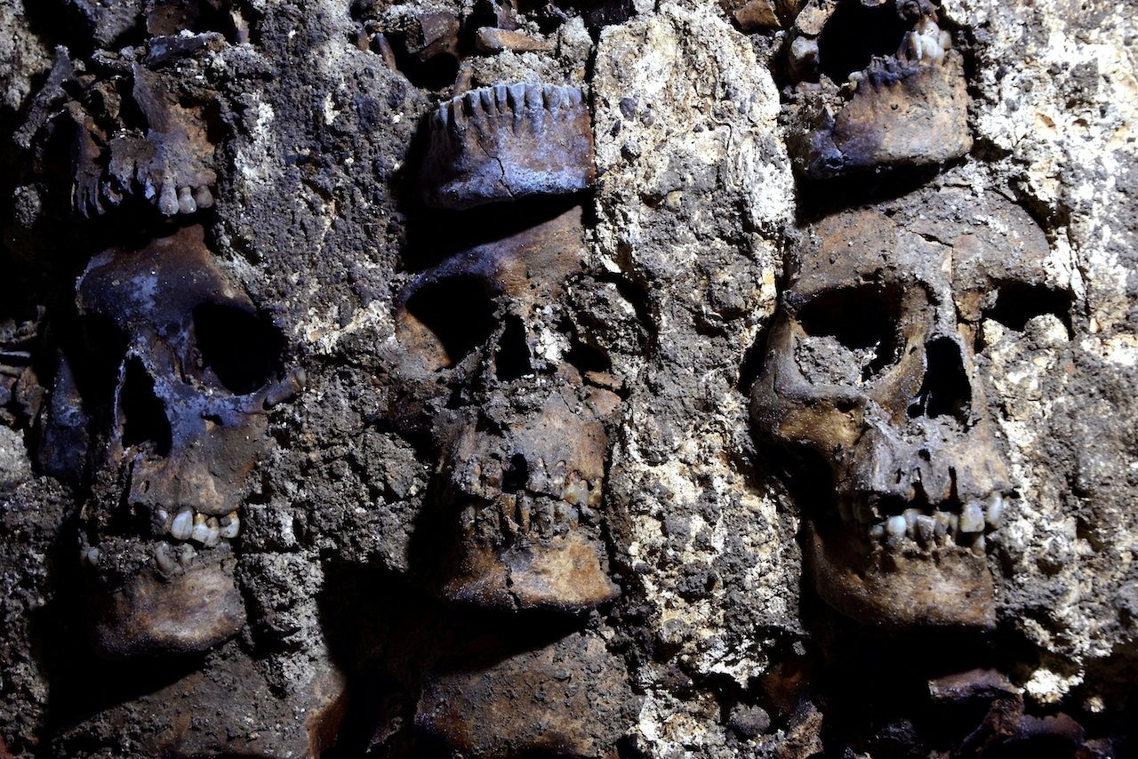A photo shows parts of an Aztec tower of human skulls, believed to form part of the Huey Tzompantli, a massive array of skulls that struck fear into the Spanish conquistadores when they captured the city under Hernan Cortes, at the Templo Mayor archaeology site, in Mexico City, Sept. 22, 2020. (National Institute of Anthropology and History via Reuters)
