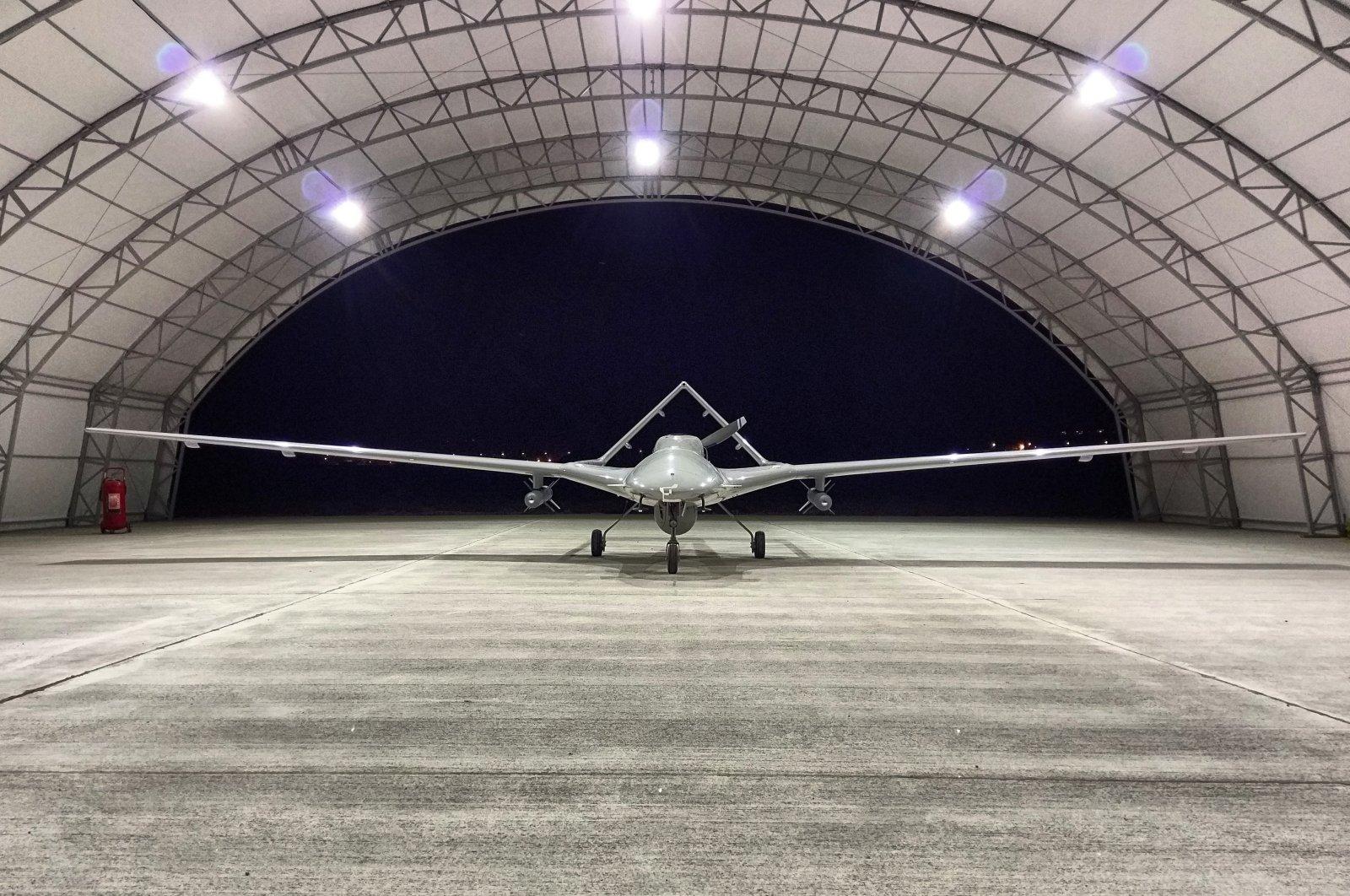 Bayraktar TB2 combat drone seen in hangar in an unnamed location. (AA Photo)