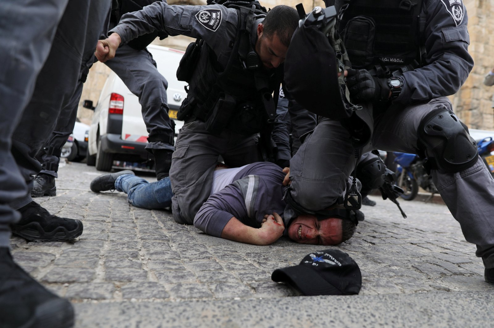 Israeli police officers detain a Palestinian protestor during scuffles outside the compound housing al-Aqsa Mosque in Jerusalem's Old City on March 12, 2019. (Reuters Photo)