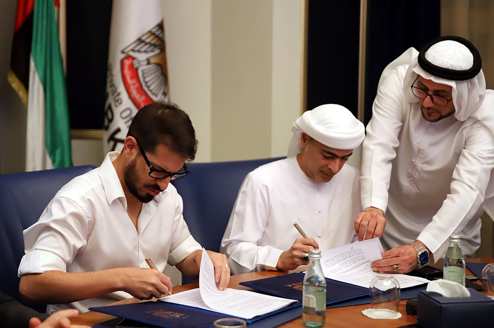 A handout photo made available by Beitar Jerusalem Club shows Moshe Hogeg (L), soccer club owner of Beitar Jerusalem, and Sheikh Hamad bin Khalifa Al Nahyan (R) during the signing of a partnership agreement between the Beitar Jerusalem soccer club and Sheikh Hamad bin Khalifa Al Nahyan, in Dubai, 08 December 2020. (EPA Photo)