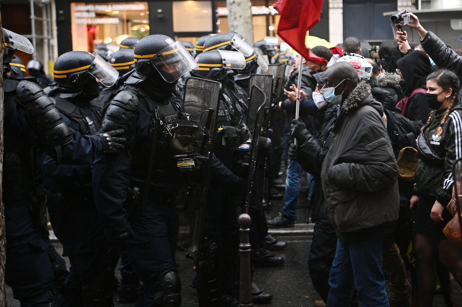 Protesters face CRS riot police during a demonstration in Paris on Dec. 12, 2020. (AFP Photo)