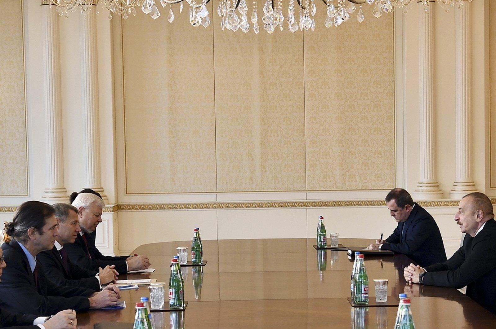 Azerbaijani President Ilham Aliyev (R), speaks to members of the OSCE Minsk Group co-chairs Stephane Visconti of France, Andrew Schofer of the U.S., Russian Ambassador to Azerbaijan Mikhail Bocharnikov and Personal Representative of the OSCE Chairperson-in-Office Andrzej Kasprzyk in Baku, Azerbaijan. (AP Photo)