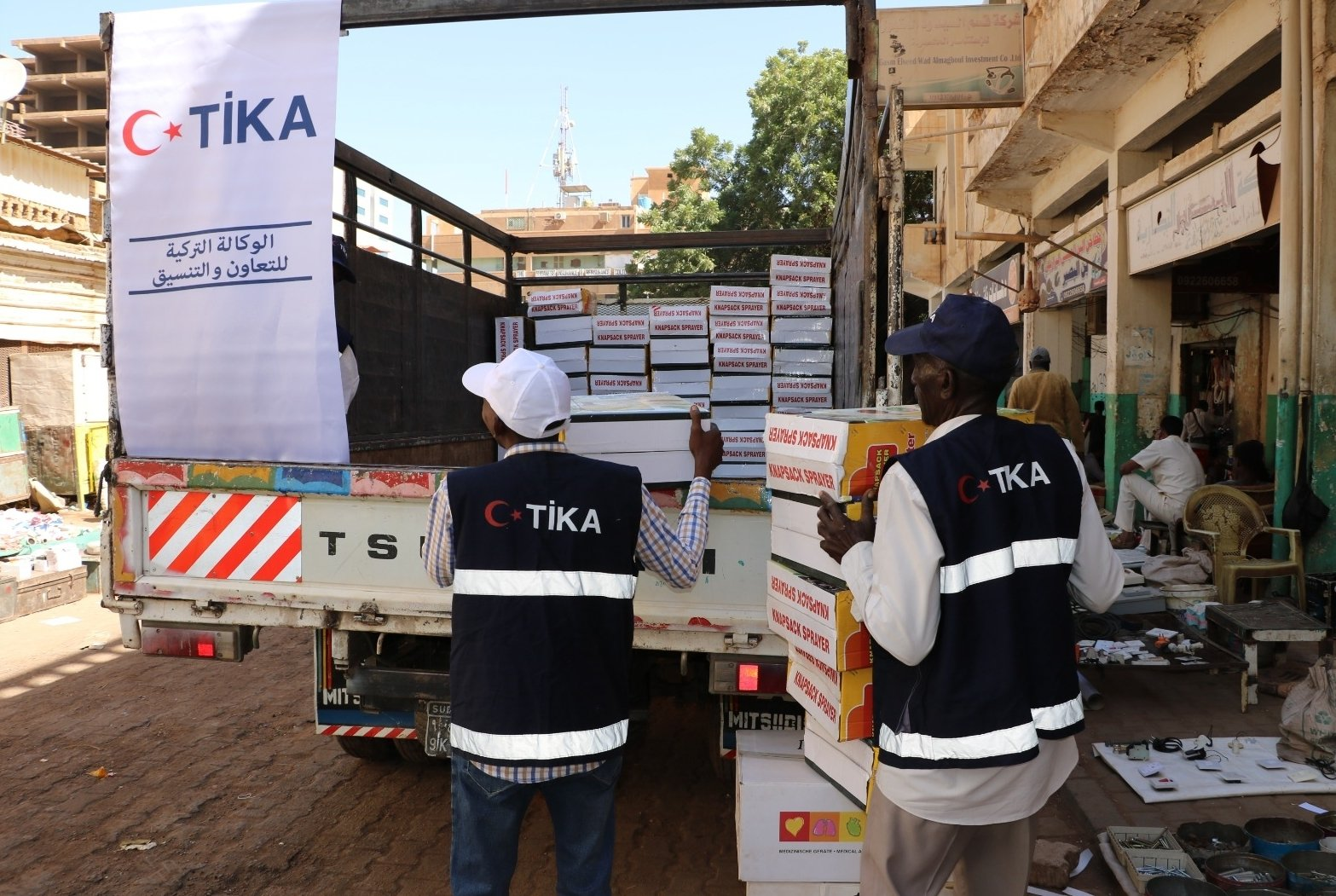 TIKA volunteers unload a truck filled with personal protective equipment (PPE) and medical supplies, in Khartoum, Sudan, Dec. 13, 2020. (AA Photo)