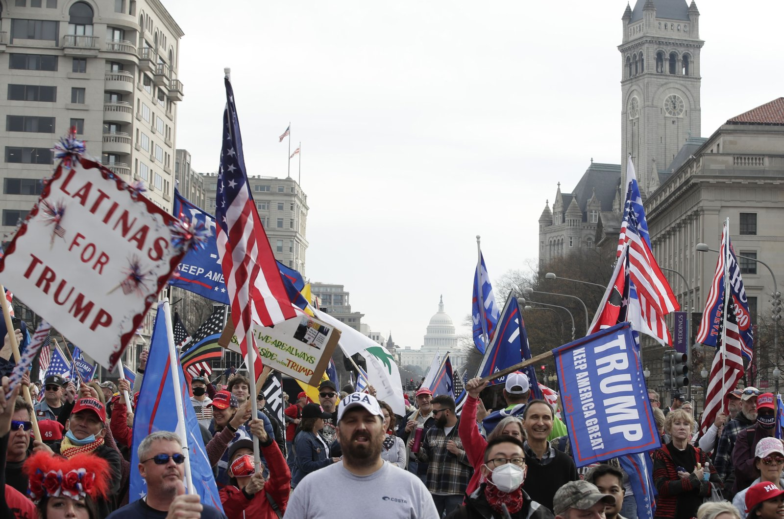 With the U.S. Capitol building in the background, supporters of President Donald Trump demonstrate during a rally at Freedom Plaza in Washington, D.C., Dec. 12, 2020. (AP Photo)