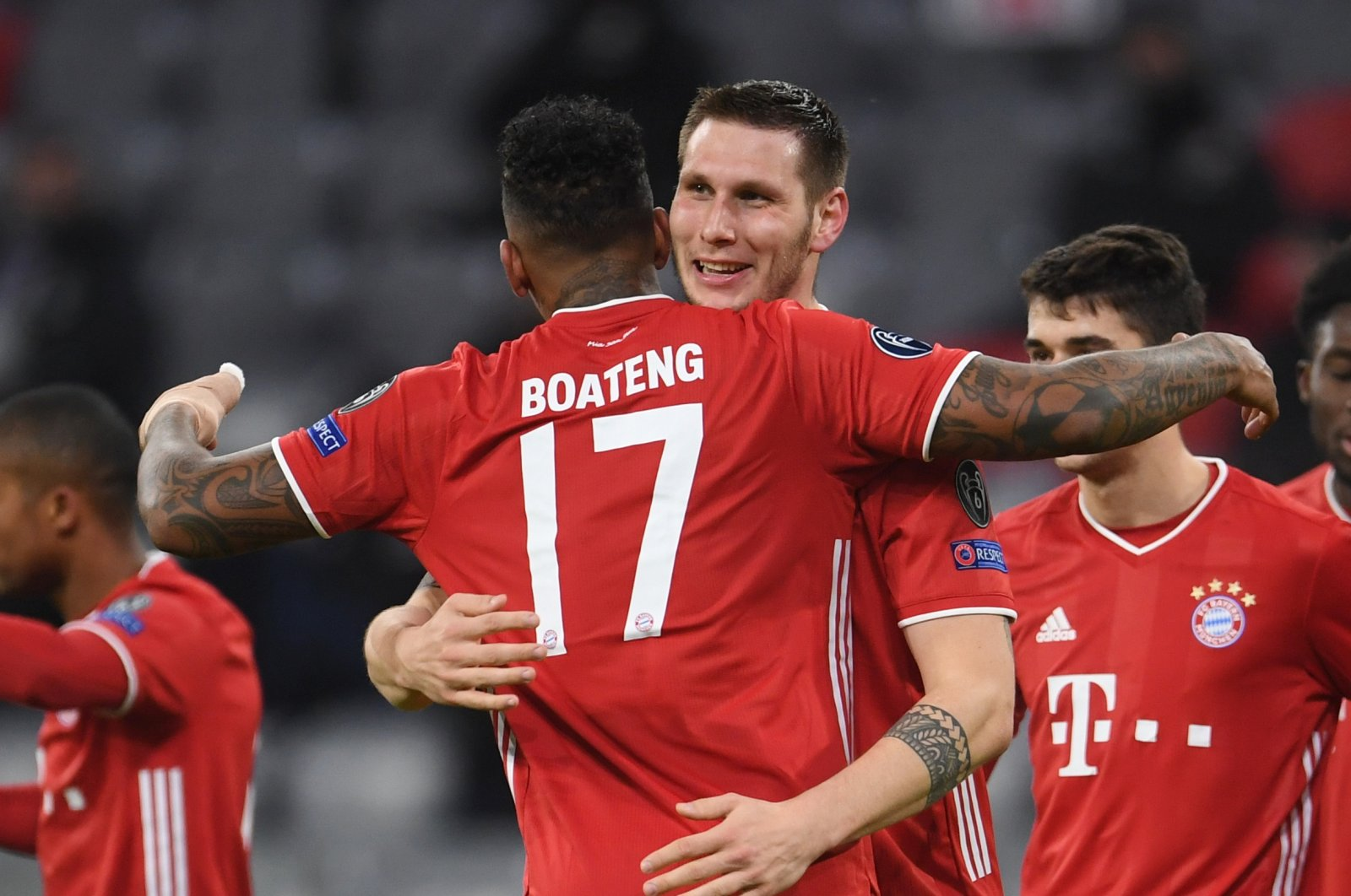 Bayern Munich's Jerome Boateng (C-L) and Nikolas Sule (C-R) celebrate a goal during a Champions League match against Lokomotiv Moscow at the Allianz Arena in Munich, Germany, Dec. 9, 2020. (Reuters Photo)