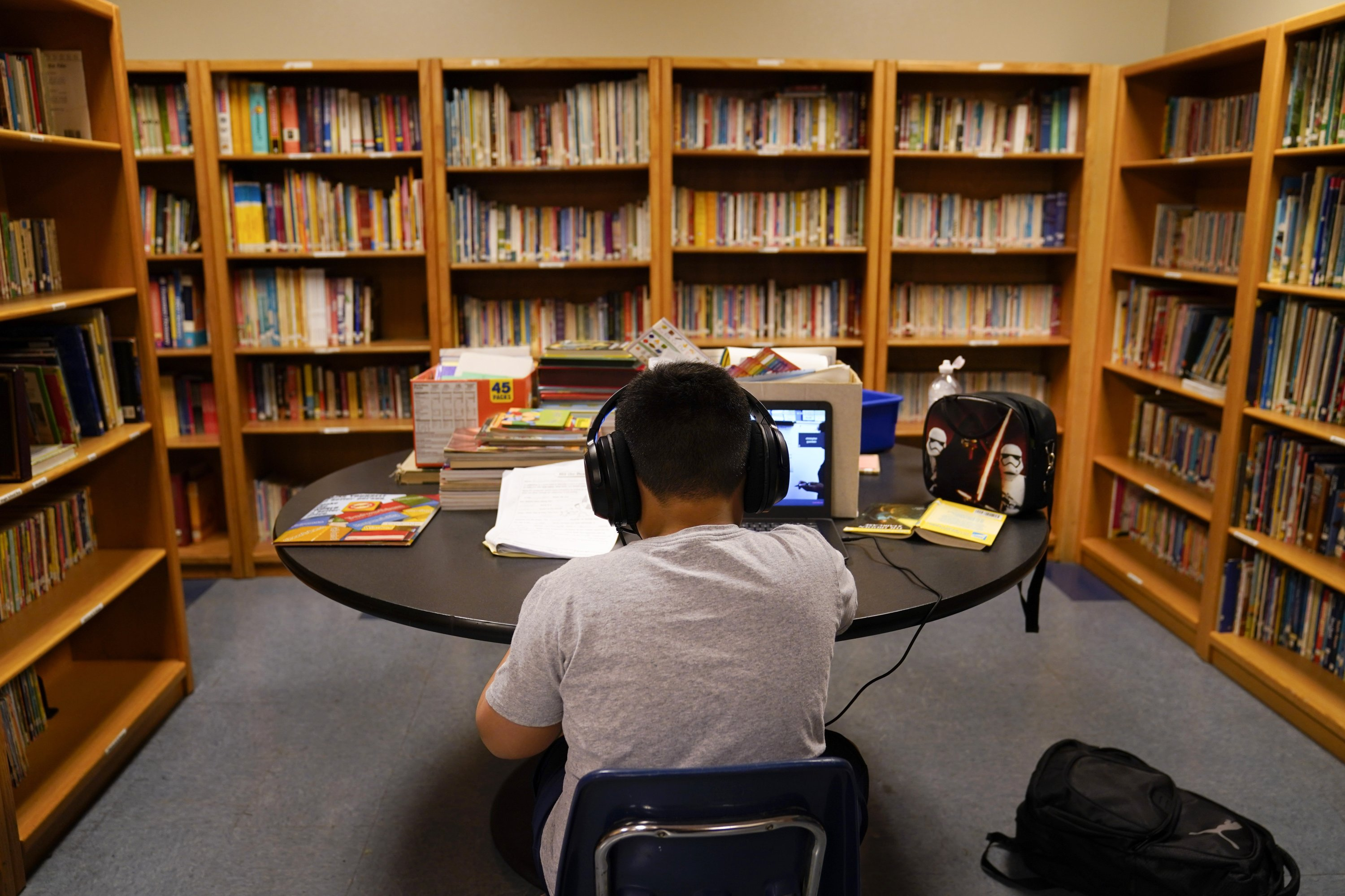 In this Aug. 26, 2020 file photo, a Los Angeles Unified School District student attends an online class at Boys & Girls Club of Hollywood in Los Angeles. (AP Photo)